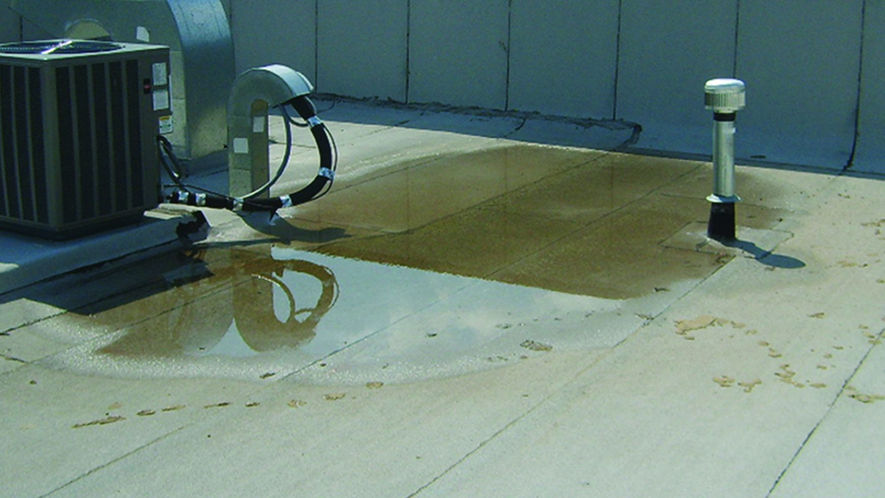 Detrimental Ponding Water On Flat Commercial Roofs