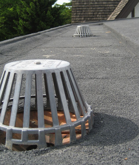 Roof Drain Installation : The most common flat roof drainage systems roofslope