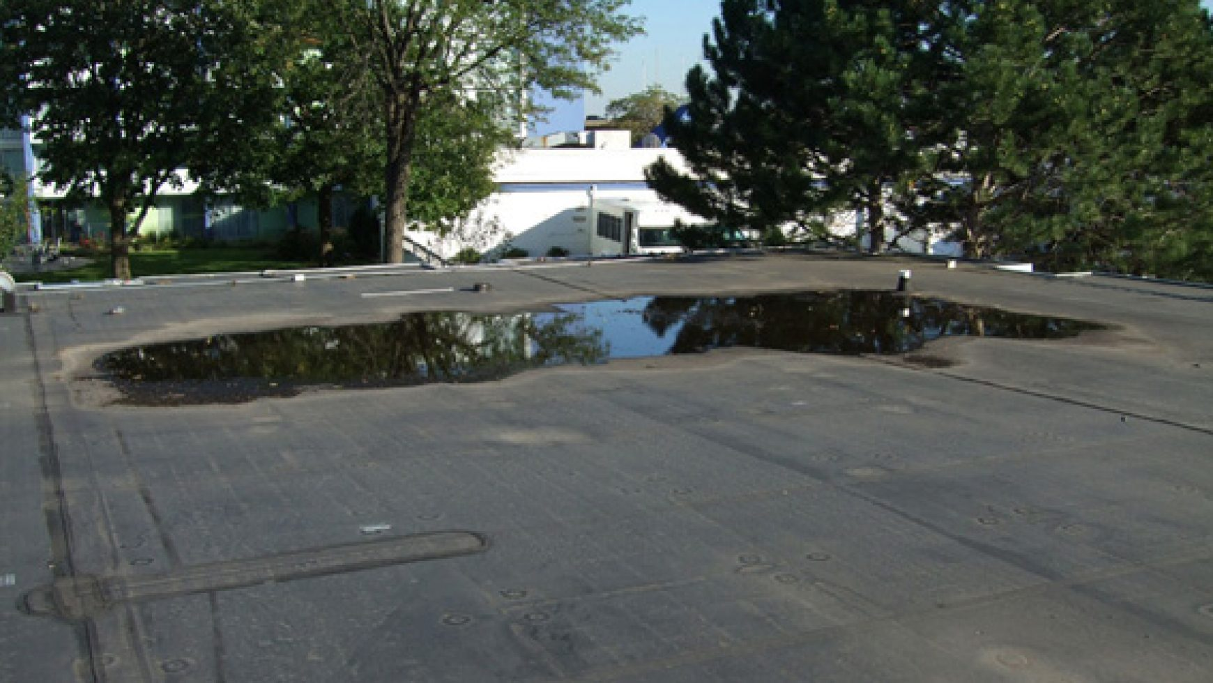 How Low Does It Go – Measuring A Flat Roof Low Spot