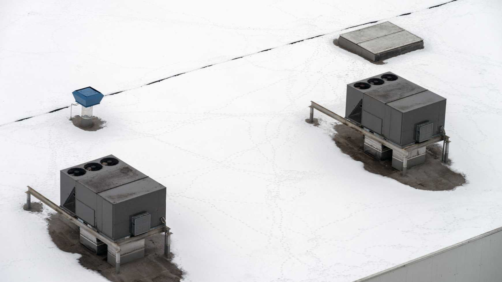 How to Safely Remove Snow from a Commercial Flat Roof