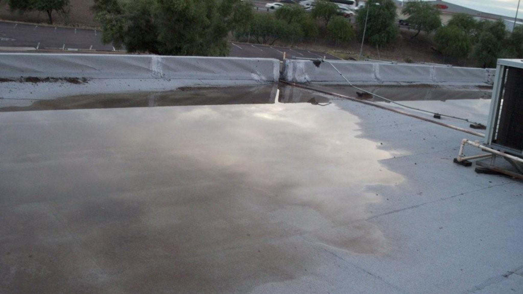 Understanding The Causes Of Flat Roof Ponding