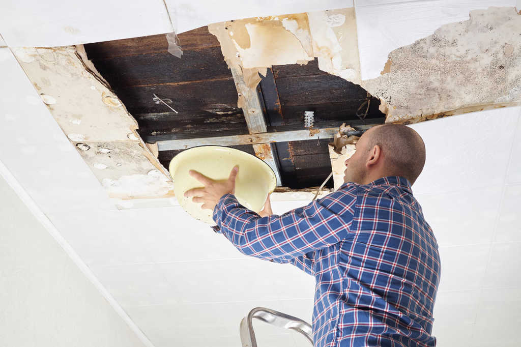 Office building ceiling damaged from flat roof leaking